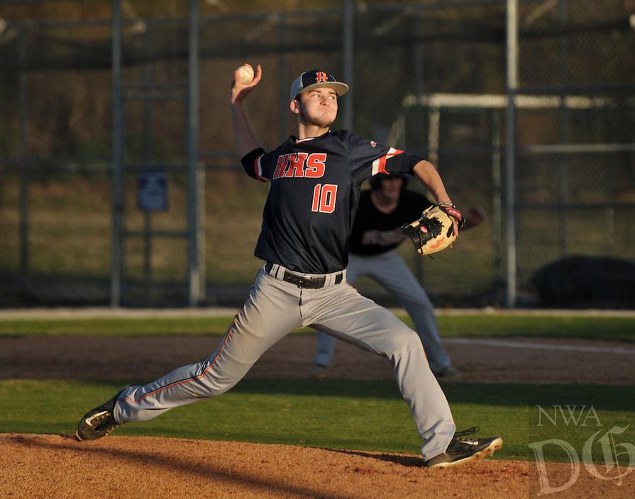 NWA Democrat-Gazette/BEN GOFF @NWABENGOFF Logan Easley of Rogers Heritage pitches against Springdale on Monday March 14, 2016 during the game at Veterans Park in Rogers.