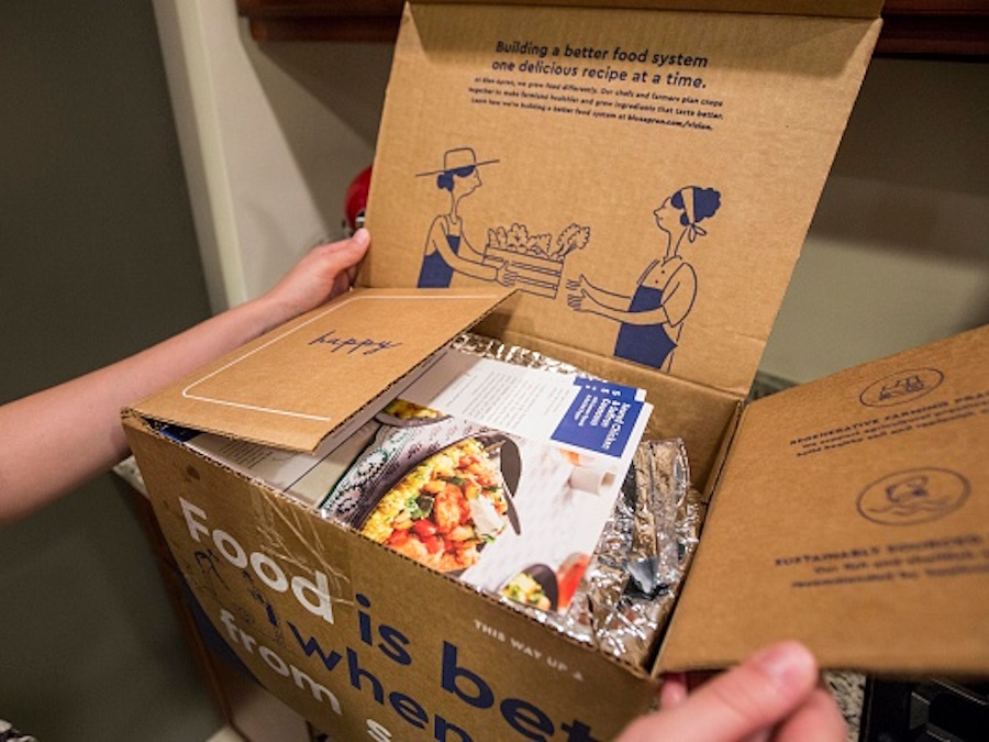 BOSTON, MA - JUNE 28: In this photo illustration, a Blue Apron customer unpacks a Blue Apron box on a kitchen counter on June 28, 2017 in Boston, Massachusetts.  The online meal-kit delivery company is going public and has lowered their upcoming IPO price range from $15 to $17 a share to $10 to $11 a share. (Photo by Scott Eisen/Getty Images)